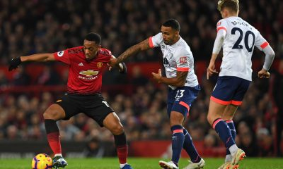 Callum Wilson and David Brooks vie for the ball against Anthony Martial