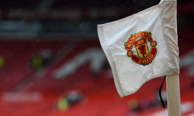 The Manchester United badge is seen on a corner flag ahead of the English Premier League football match between Manchester United and Manchester City at Old Trafford in Manchester, north west England on April 12, 2015. AFP PHOTO / PAUL ELLIS RESTRICTED TO EDITORIAL USE. No use with unauthorized audio, video, data, fixture lists, club/league logos or live services. Online in-match use limited to 45 images, no video emulation. No use in betting, games or single club/league/player publications. (Photo credit should read PAUL ELLIS/AFP via Getty Images)
