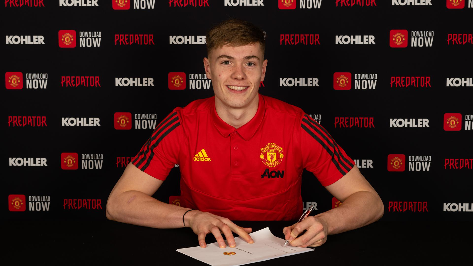 Nathan Bishop signs a contract with Manchester United at ATC on 30 January 2020. Photographer: Ashley Donelon. (Manchester United website)