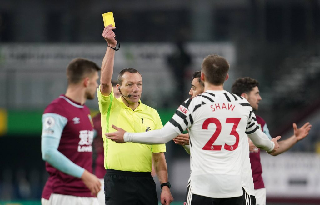 Luke Shaw reacts after being book by referee Kevin Friend against Burnley. (imago Images)