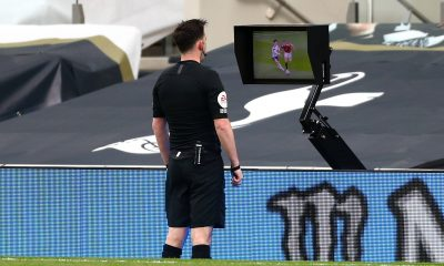 Referee Chris Kavanagh consults the pitch-side monitor to check Scott McTominay's foul on Son in Spurs' defeat to Manchester United. (imago Images)